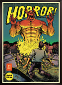 Classic horror comic book cover with devil and graveyard