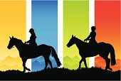Two horse riders in silhouette against a beautiful seasonal background.