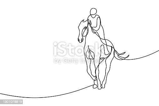 istock Horseback rider 1301078819