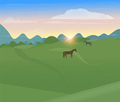Sunset in the field against the background of mountains. Rural geometric landscape in minimalistic style