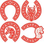 Horseshoe symbol designs set in Chinese paper cut style to celebrate the CNY