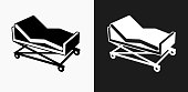 Hospital Bed Icon on Black and White Vector Backgrounds. This vector illustration includes two variations of the icon one in black on a light background on the left and another version in white on a dark background positioned on the right. The vector icon is simple yet elegant and can be used in a variety of ways including website or mobile application icon. This royalty free image is 100% vector based and all design elements can be scaled to any size.