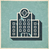 istock Hospital building. Icon in retro vintage style - Old textured paper 1338404250