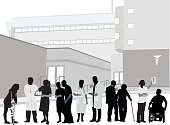 A vector silhouette illustration of hospital staff and patients standing outside in front of a hospital building.  There is a woman on crutches, a doctor looking to the side, a nurse with a tray of medication, an elderly couple, a nurse and doctur with clipboard, another elderly couple where the woman has a cane, a female doctor holding up an x-ray and a man in a wheelchair.