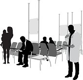 A vector silhouette illustration of a hospital waiting room with patients wating to see a doctor who is standing calling names of a clipboard.  Patients include a mother holding her baby and a business man hunched over reading a tablet.