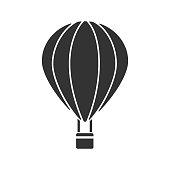 Hot air balloon glyph icon. Vector silhouette