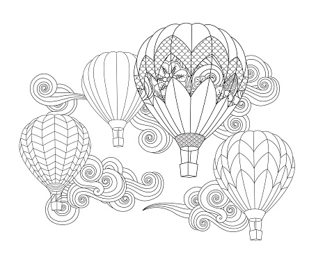 hot air balloon in doodle inspired doodle style isolated on white.