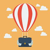 Hot air balloon with suitcase full of money