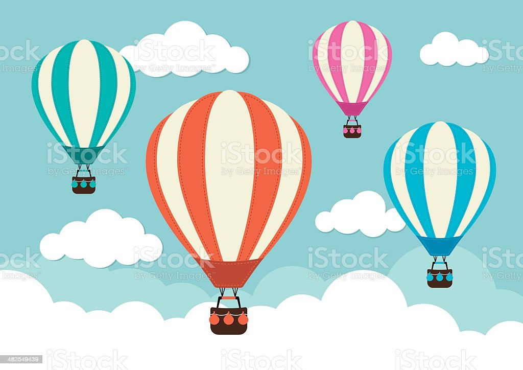 4 hot air balloons in the clouds
