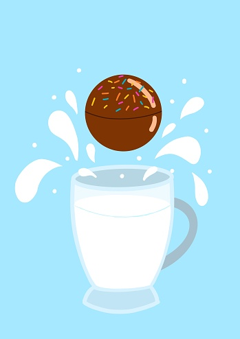 hot chocolate bomb with milk splash on a blue background and with a mug of milk