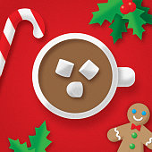 Vector illustration of a cup of hot chocolate with gingerbread man, candy cane and holly against a red background in flat style.