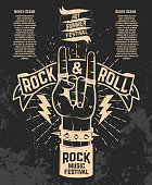 Hot summer festival. Human hand with rock and roll sign.