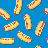 Vector illustration of hotdogs in a repeating pattern against a blue background.