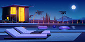 House and swimming pool with deck chairs and balls in water at night. Vector cartoon summer landscape with illuminated villa, basin on lawn, palms and moon in sky