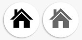 House Black and White Round Icon. This 100% royalty free vector illustration is featuring a round button with a drop shadow and the main icon is depicted in black and in grey for a roll-over effect.