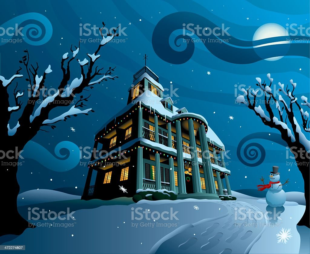 House covered in snow and christmas lights with snowman stock