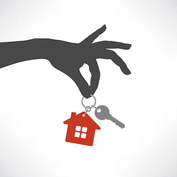 House key A female hand holding a key and a little red house house key stock illustrations