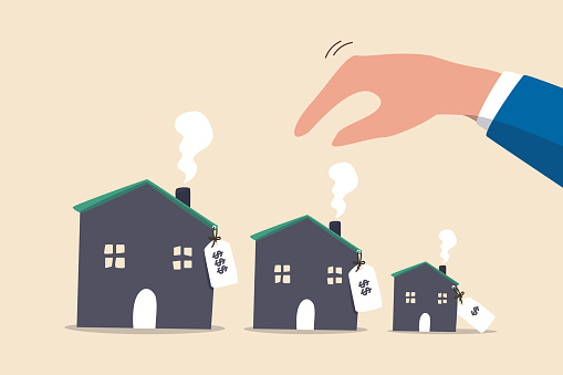 House or mortgage affordability calculation, picking new home base on budget, income or lifestyle concept, businessman hand wisely think to picking different variant houses with price tag.