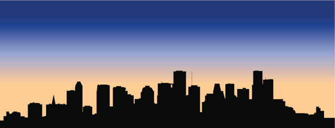 Houston skyline silhouetted against the sunset