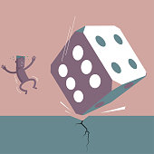 Huge dice fell down,the man was scared.Isolated on brown background.