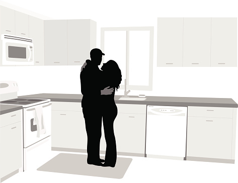 Hugging Couple At Home
