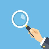Human hand holding magnifying glass, Flat design graphic. Vector illustration