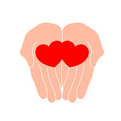 Human hand holding red heart.