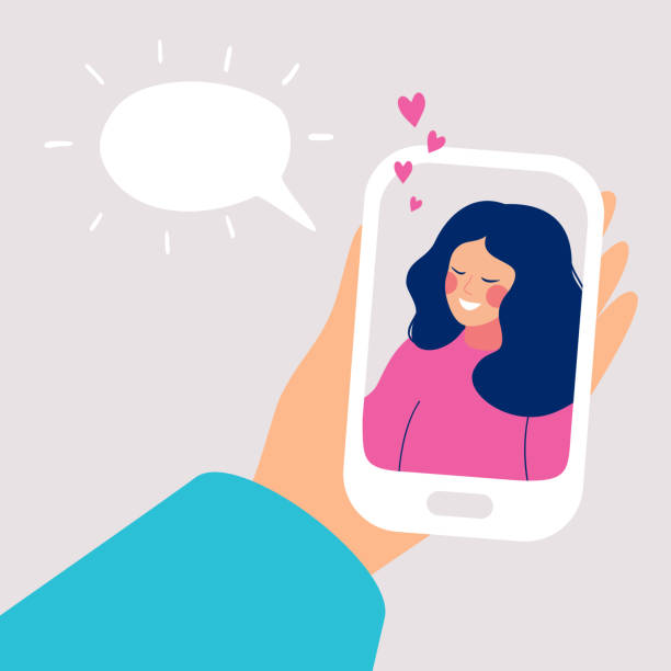 Human hand holds mobile smartphone with smiling young woman on display Human hand holds mobile smartphone with smiling young woman on display. Speech bubble above. Vector cartoon illustration of phone conversation girlfriend stock illustrations