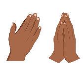 Human hands folded in prayer