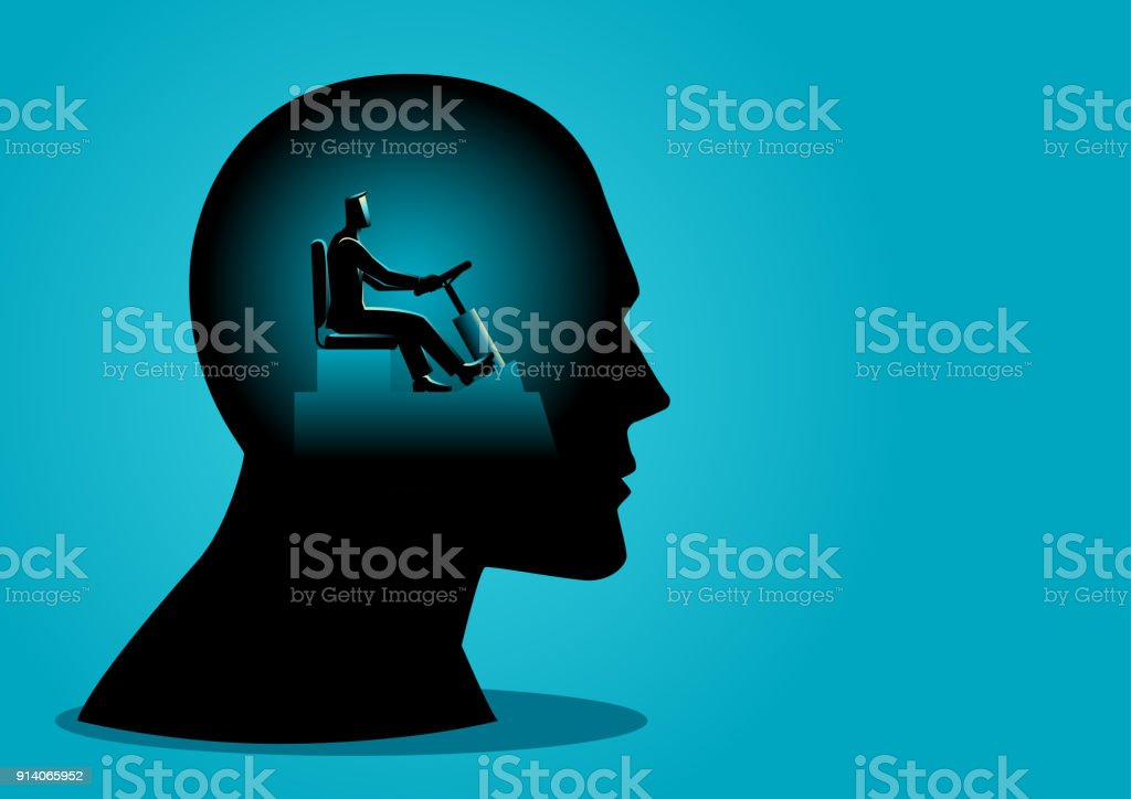 Human head being controlled by a businessman