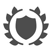 Human rights emblem solid icon. Lawyer shield in laurel wreath. Jurisprudence vector design concept, glyph style pictogram on white background, use for web and app. Eps 10.