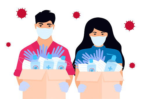 COVID-19. Humanitarian aid. Volunteers deliver medical protective masks, gloves and disinfectants. Coronavirus epidemic.
