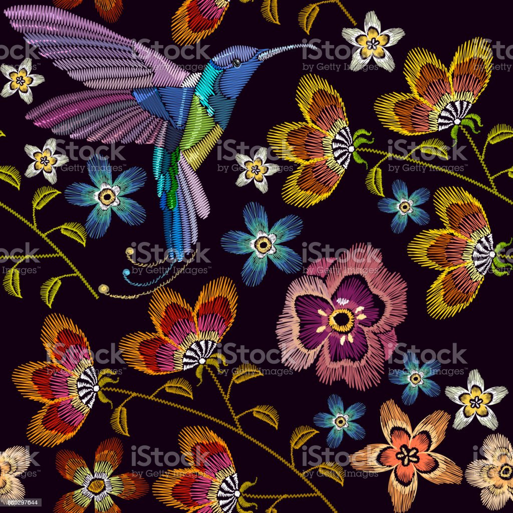 Humming bird and flowers embroidery seamless pattern. Template for clothes, textiles, t-shirt design. Beautiful hummingbirds and spring flowers embroidery on black background vector art illustration