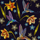 Humming bird and yellow narcissuses embroidery exotic tropical flowers seamless pattern. Beautiful flowers embroidery, humming-bird, orchids, tropical flowers