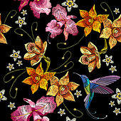 Humming bird, orchid exotic tropical flowers seamlees pattern. Beautiful classical embroidery, humming-bird, orchids, tropical flowers. Template for clothes, embroideries, t-shirt design