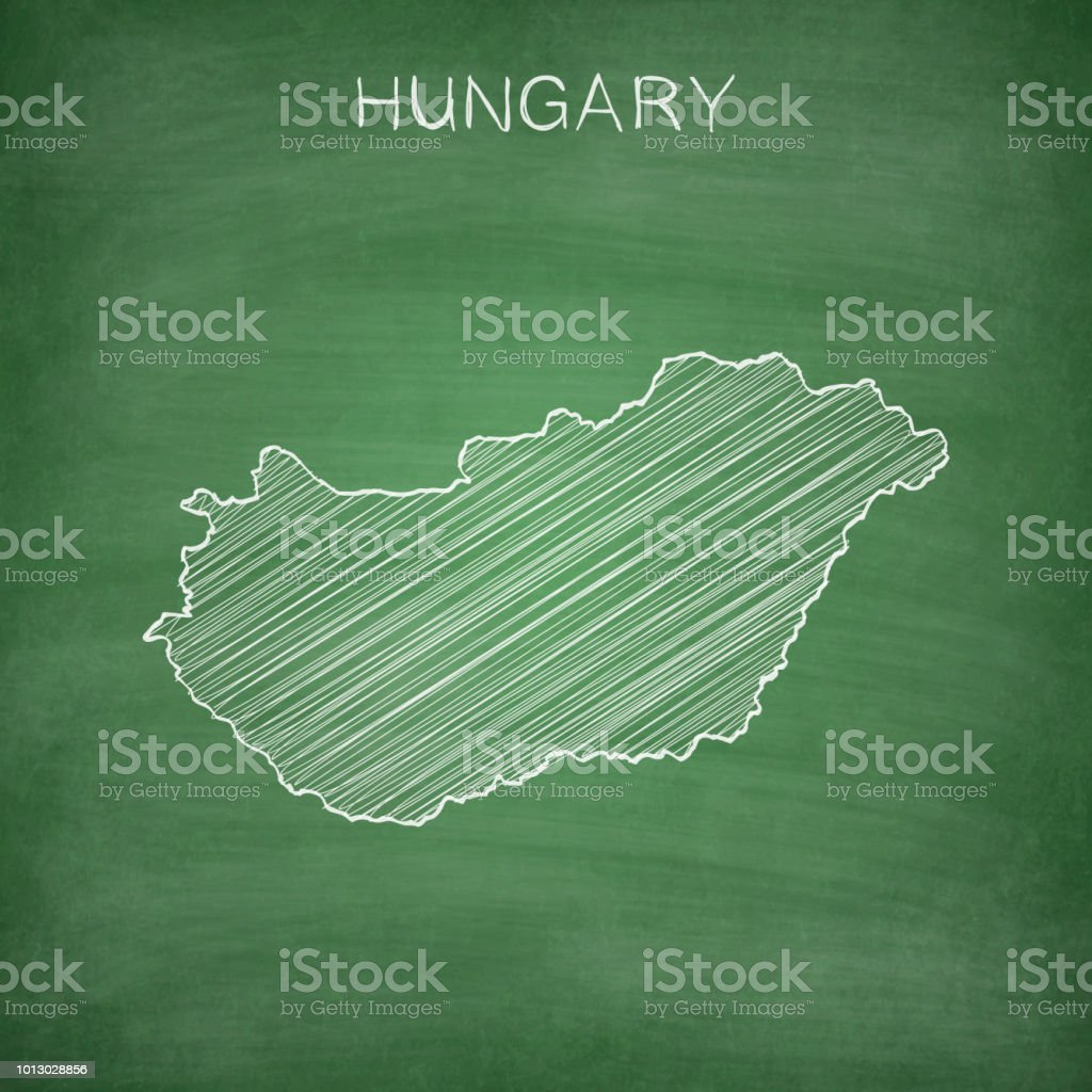 Map of Hungary drawn in chalk on a green chalkboard with chalk...