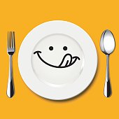 Hungry face draw on white plate with spoon and fork