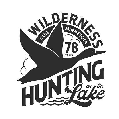 Hunting club t-shirt print, flying duck above lake
