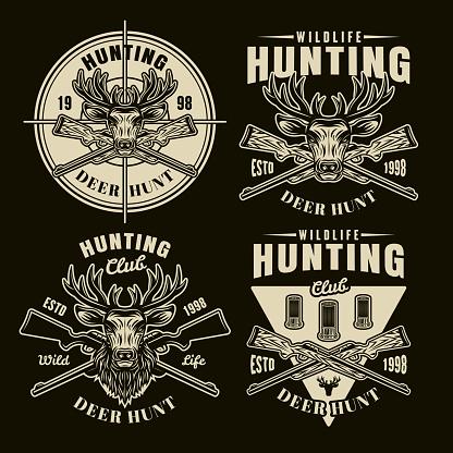 Hunting set of four vector light emblems, badges, labels or symbols in vintage style on dark background