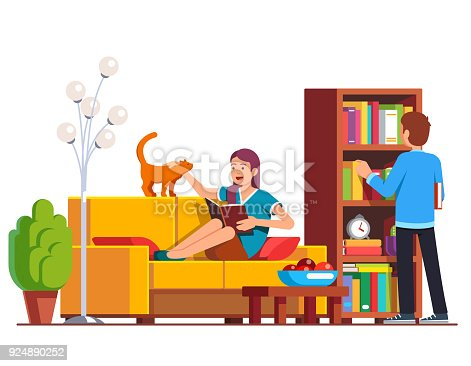 Husband, wife relaxing and reading at living room