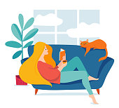 Vector hygge illustration with a woman sitting on a sofa and reading a book