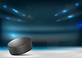 Ice hockey puck in hockey arena with goal, tribunes and lights in blurred background - vector illustration