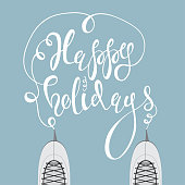 Ice skates and text Happy Holidays vector.