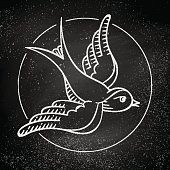 Icon bird for tattoo isolated on black chalkboard background