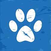 Vector of Icon Dog Paw on Blue Grunge Background