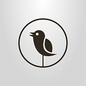 black and white icon of an abstract bird in a round frame