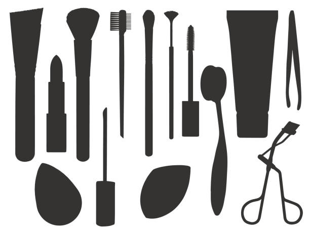 icon vector set of different makeup tools like brushes, lipstick, sponge, mascara or tweezers - błyszczyk stock illustrations