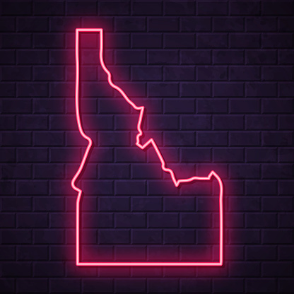 Map of Idaho in a realistic neon sign style. The map is created with a pink glowing neon light on a dark brick wall. Modern and trendy illustration with beautiful bright colors. Vector Illustration (EPS10, well layered and grouped). Easy to edit, manipulate, resize or colorize.