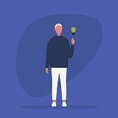 Idea Concept. Problem solving. Aha moment. Young male character pointing a finger on the light bulb / flat editable vector illustration, clip art
