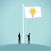 Two people raise a flag to advertise their good idea